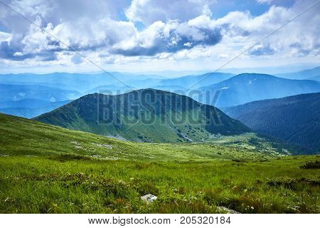 A beautiful landscape with clouds in the summer in the mountains.