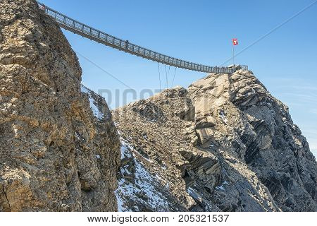 the world's first suspension bridge connecting two mountain peaks, Peak Walk at Glacier 3000 in Switzerland
