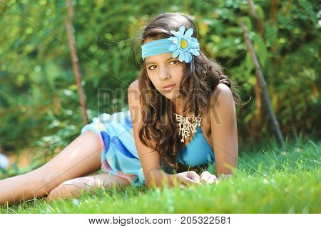 Close Up Portrait Of Beautiful  Girl With A Mysterious Look. Charming Lady With Pink Head Band With