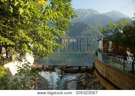 beautiful natural landscape of mountains with reflection in a clean lake in summer