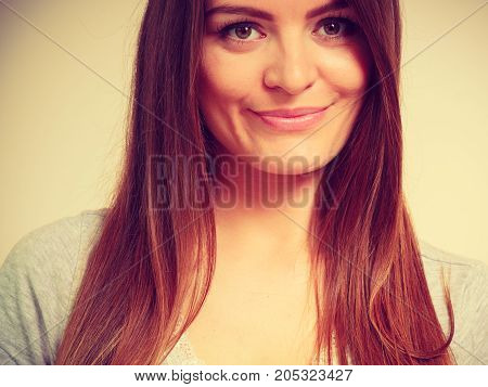 Portrait feminity joy concept. Happy smiling beautiful woman with brown hair indoor shot