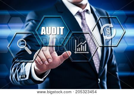 Business, technology, internet concept on hexagons and transparent honeycomb background. Businessman pressing button on touch screen interface and select audit