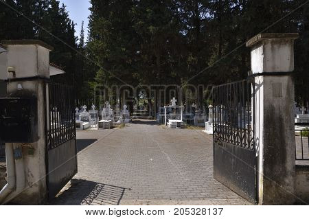 Entrance to a typical graveyard from a small village in the North of Greece.