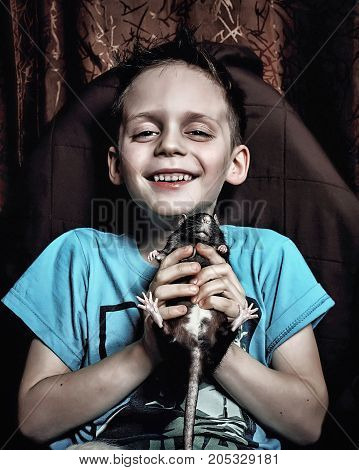 little cheerful boy with rat in your hands