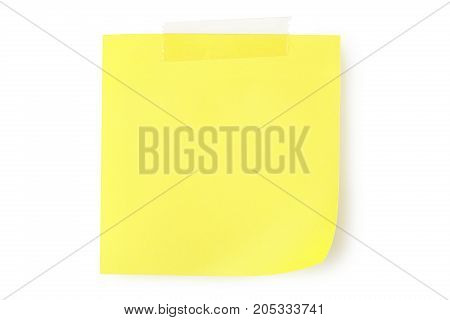 blank yellow note with adhesive tape isolated