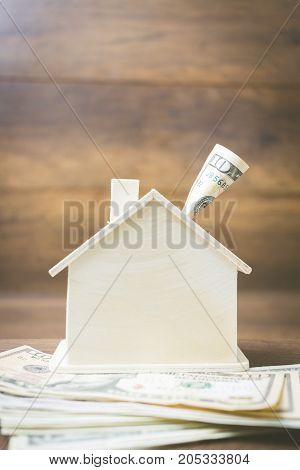 Money And House Model On Wooden Background , Finance And Banking Concept.