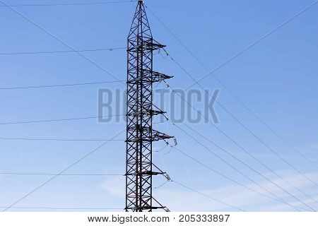 metallic electric pole against the blue sky .