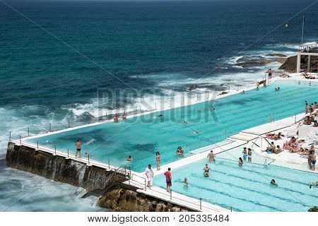 SYDNEY,NSW,AUSTRALIA-NOVEMBER 21,2016: Elevated view over Icebergs Pool with people on the Pacific Ocean waterfront at Bondi Beach area in Sydney, Australia.