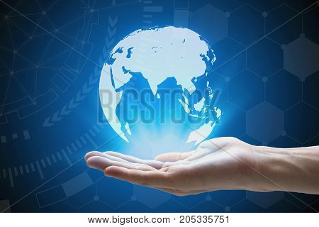 Man hand holding global network and global communication hand holding a glowing earth connected World.