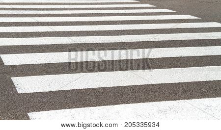 A worn-out pedestrian crossing on a country road