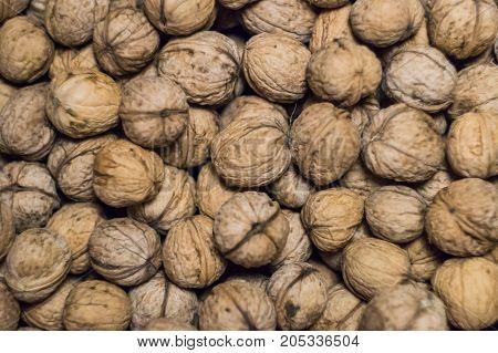 Walnuts background Walnuts texture Top view Pile of walnuts