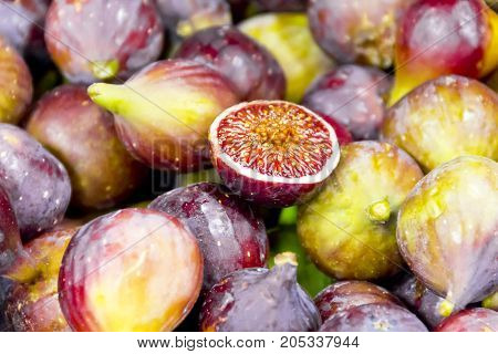 Background of appetizing figs on counter in market place