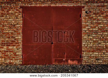 Red garage door. Red metal door. Garage door. Red door. Metal door. Grunge red. Grunge background.