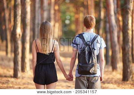So cute girlfriend with her boyfriend. Standing back side. Family first. Future family.