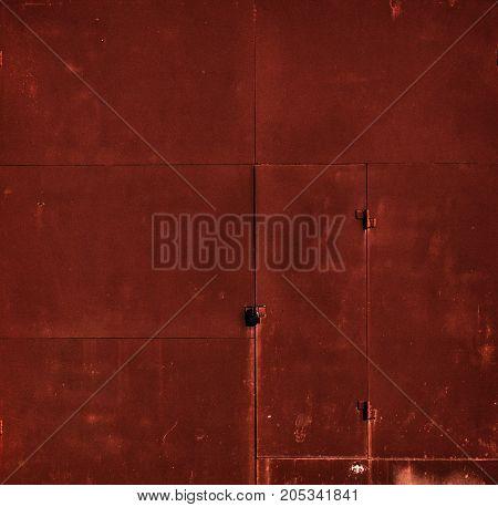 Red door. Fragment red garage door. Red metal door. Garage door. Metal door.Red metal background. Grunge background. Red grunge.