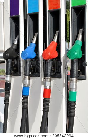 Four the nozzle for different types of motor fuel