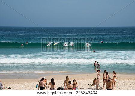 SYDNEY,NSW,AUSTRALIA-NOVEMBER 21,2016: Kids surfing and bodyboarding on the Pacific Ocean coast at Bondi Beach in Sydney, Australia.