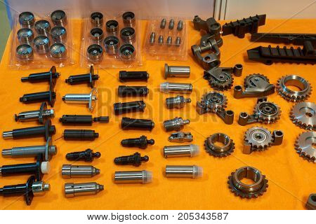 Automobile spare parts on the table. Valve damper gears gearings stuffing boxes.
