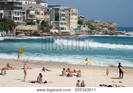 SYDNEY,NSW,AUSTRALIA-NOVEMBER 21,2016: Surfing, waterfront architecture and rocky cliffs on the Pacific Ocean coast at Bondi Beach in Sydney, Australia.