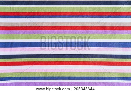 Textile multicolored stripes fabric as a background