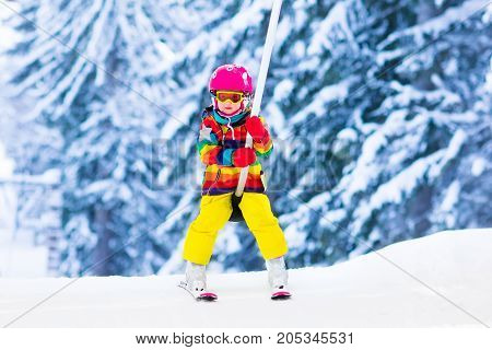 Child On Ski Lift In Snow Sport School In Winter Mountains