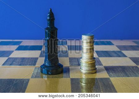 Coins are formed like a king on a chessboard. Near the chess piece