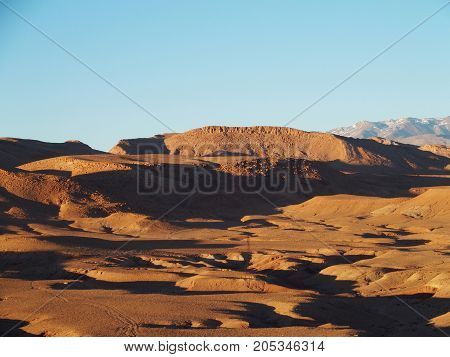 Desert and high ATLAS MOUNTAINS range landscape in central MOROCCO seen from ksar of Ait-Ben-Haddou near Ouarzazate city with clear blue sky in 2017 warm sunny winter day, northern Africa on February.