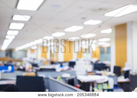 Blurred image of busy office with out people background.