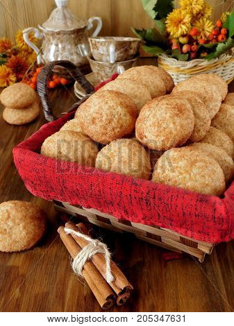 Biscuits with cinnamon in a wicker basket on a wooden background