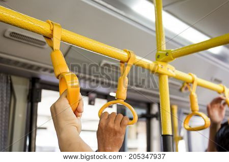 Bus handle rail for standing passenger close up.