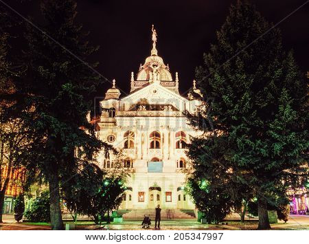 Famous State theater building in Kosice Slovak republic. Night photo. Architectural scene. Travel destination. Yellow photo filter.
