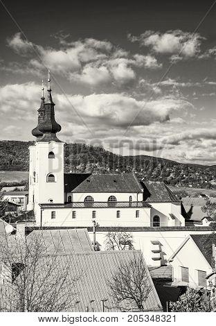 Roman catholic church in Divin village Slovak republic. Religious architecture. Cultural heritage. Black and white photo.