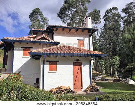Country house made with adobe, brick and tile roof.