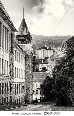 Old real school in mining town Banska Stiavnica Slovak republic. Travel destination. Black and white photo.