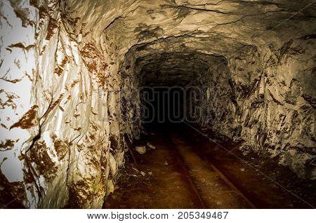 tunnel, rocks and rails underground in mine