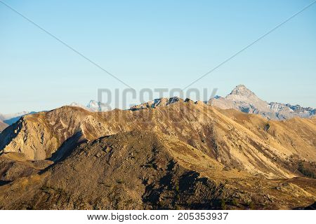 High Altitude Pasture, Rocky Mountain Peaks And Jagged Ridge, With Scenic Sky, The Italian Alps. Exp