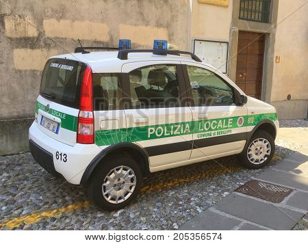 Bergamo, Lombardije, Italy -  August 17, 2017: Italian local police car, Fiat Panda, parked on a public parking spot in the city of Bergamo. Nobody in the vehicle.