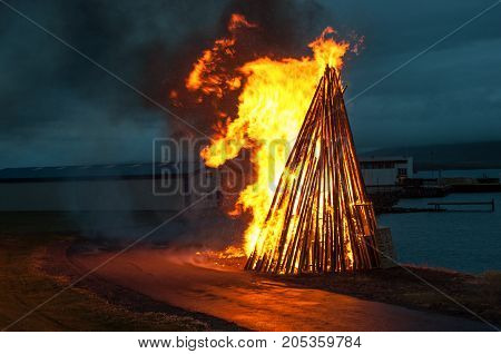 bonfire at a midsummer festival on the island of Hrisey in Iceland