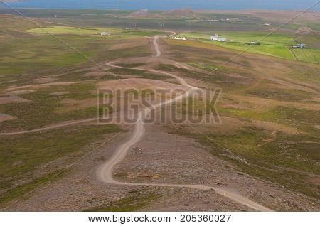 Icelandic gravel road on Borgaras in North Iceland