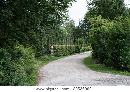 Gravel Road In Summerhouse Area On The Island Of Oroe In Denmark