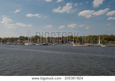 sailboats in Rostock harbour on a sunny day