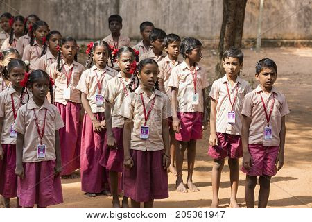 PONDICHERY PUDUCHERY INDIA - SSEPTEMBER 04 2017. School parade of each monday morning with children students in uniforms. They walk sing and pray before going in the classrooms.