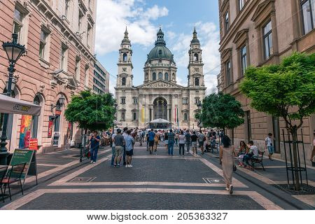 BUDAPEST, HUNGARY - 22 AUGUST 2017: Area with visitors near St. Stephen's Basilica, the largest church in Budapest, Hungary.
