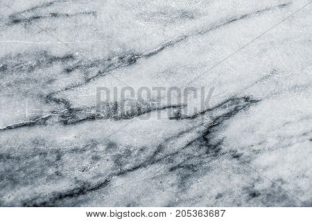 Texture of grey marble with black stains, scratches, scuffs