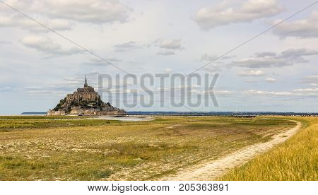 View of the footpath leading to the famous Mont Saint Michel Abbey in Normandy in North of France.