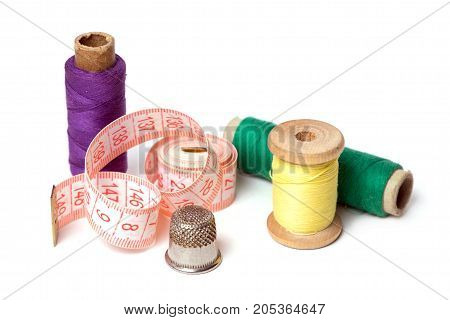 Colorful thread spools used in fabric and textile industry. Accessories for needlework.