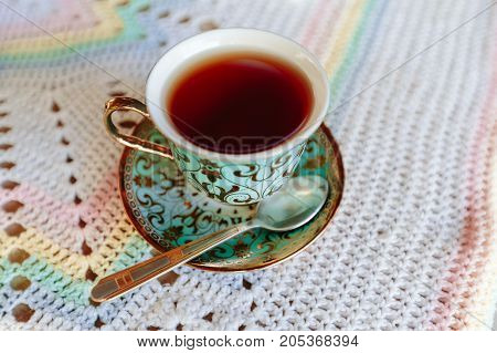 cup of strong black fragrant tea on a close-up table