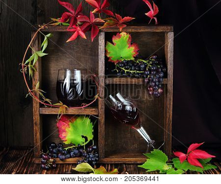 red wine in a crystal glass with grapes