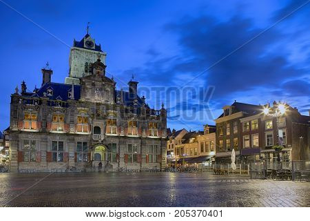 Travel Concepts and Ideas. Stadhuis (Known as City Hall) at Local Markt Square (Market Place) in Dutch Old City Delft during Blue Hour in Holland the Netherlands. Horizontal Image