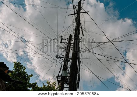 lot of different wires and connections on the electric pole